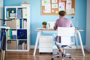 man studying at organized desk